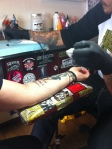 Mom getting her tattoo